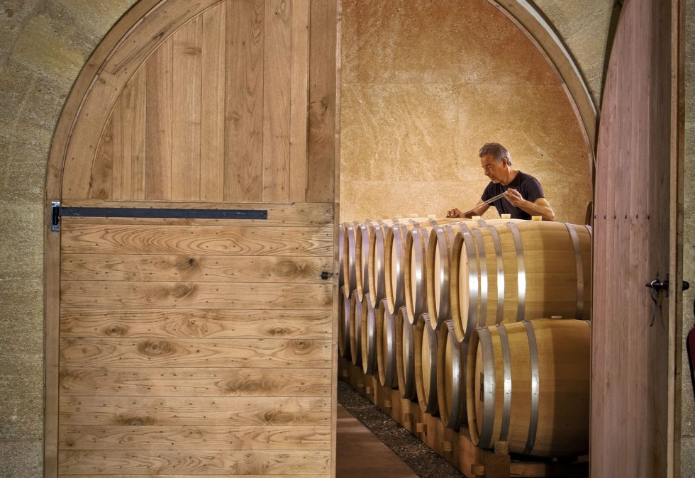 winemaker and wine barrels